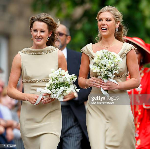 Lady Catherine Valentine and Chelsy Davy in their role as bridesmaids attend the wedding of Lady Melissa Percy and Thomas Van Straubenzee at St...