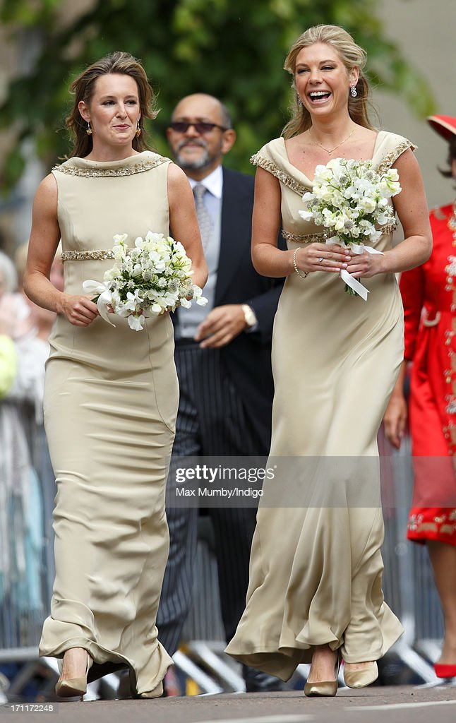 Lady Catherine Valentine and Chelsy Davy, in their role as bridesmaids, attend the wedding of Lady Melissa Percy and Thomas Van Straubenzee at St Michael's Church on June 22, 2013 in Alnwick, England.