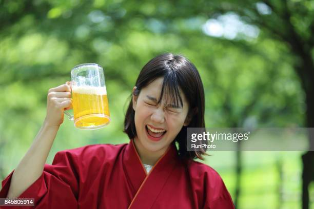 lady chef who is willing to have a beer glass