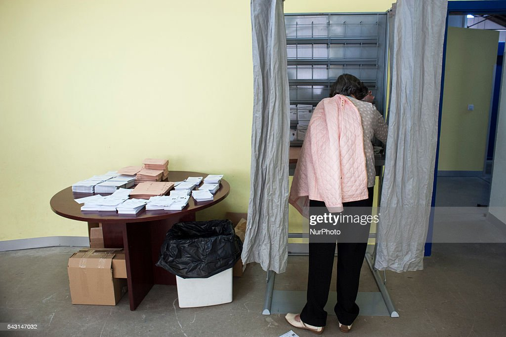 A lady chooses his vote at a polling station in Santander in prepared sites for this . Spanish voters head back to the polls after the last election in December failed to produce a government. Latest opinion polls suggest the Unidos Podemos left-wing alliance could make enough gains to come in second behind the ruling center right Popular Party.