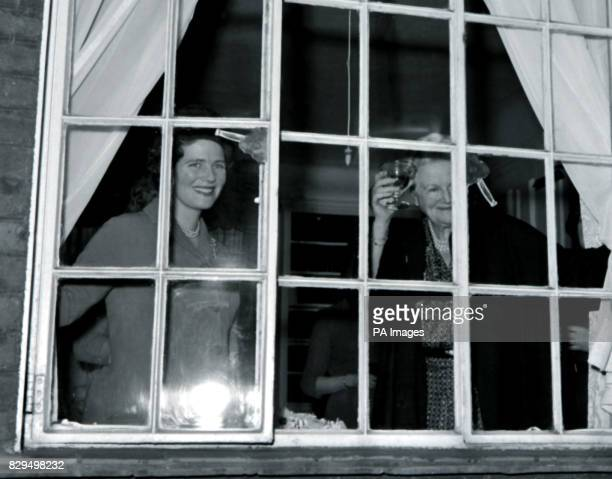 Lady Churchill raises a glass of champagne in toast to her husband's 86th birthday as she stands at the window of their home in Hyde Park Gate London...