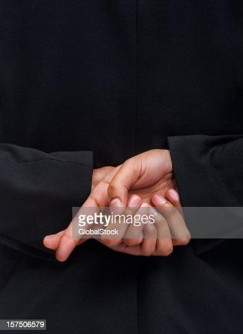 Lady crossing fingers