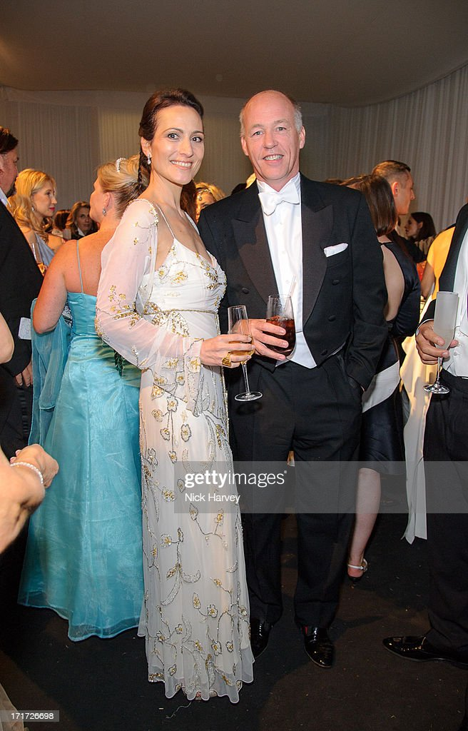 Lady Dalit Nuttall and Sir Harry Nuttall attend the 15th Annual White Tie and Tiara Ball to Benefit Elton John AIDS Foundation in Association with Chopard at Woodside on June 27, 2013 in Windsor, England. No sales to online/digital media worldwide until the 14th of July. No sales before July 14th, 2013 in UK, Spain, Switzerland, Mexico, Dubai, Russia, Serbia, Bulgaria, Turkey, Argentina, Chile, Peru, Ecuador, Colombia, Venezuela, Puerto Rico, Dominican Republic, Greece, Canada, Thailand, Indonesia, Morocco, Malaysia, India, Pakistan, Nigeria. All pictures are for editorial use only and mention of 'Chopard' and 'The Elton John Aids Foundation' are compulsory. No sales ever to Ok, Now, Closer, Reveal, Heat, Look or Grazia magazines in the United Kingdom. No sales ever to any jewellers or watchmakers other than Chopard.