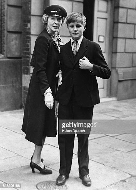 Lady Diana Cooper stands with her son Alfred in London after returning from Algiers