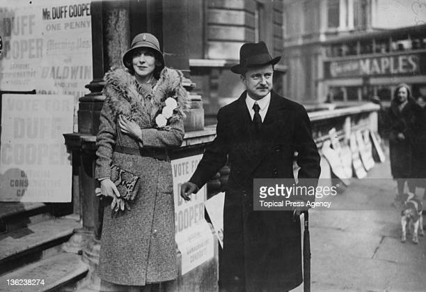 Lady Diana Cooper with her husband Conservative politician Alfred Duff Cooper during his campaign in the Westminster St George's byelection London...