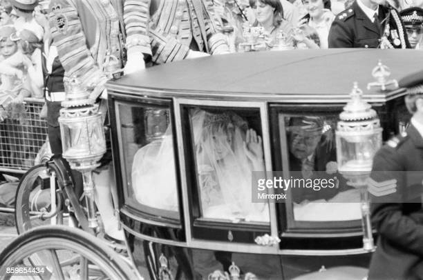 Lady Diana Spencer and her father Earl Spencer in the Royal Carriage that leaves Clarence House for St Paul's Cathedral for Diana's wedding to Prince...