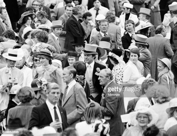 Lady Diana Spencer towards the left in the ribbon banded hat and striped top enjoys the day with some friends on the last day of Royal Ascot A few...
