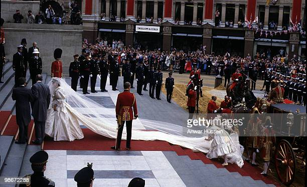 Diana Princess of Wales wearing an Emanuel wedding dress enters St Paul's Cathedral on the hand of her father Earl Spencer for her marriage to Prince...