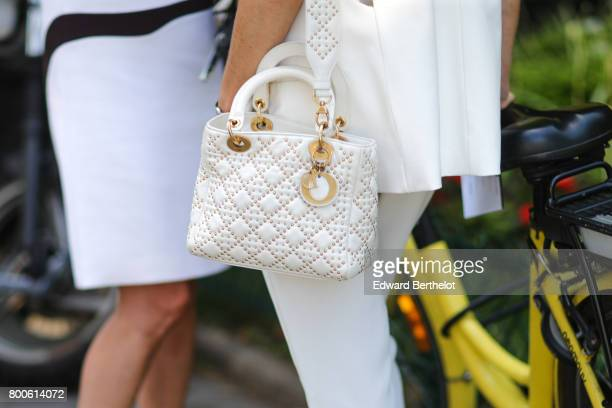 Lady Dior white bag is seen outside the Dior show during Paris Fashion Week Menswear Spring/Summer 2018 on June 24 2017 in Paris France