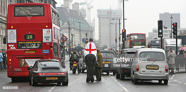 A lady dressed as St George heads out of Parliament Square on horseback on April 23 2008 in London England England celebrates Saint George's Day today