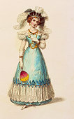 A lady dressed in an early 19th century waisted evening dress with a wide lace hem low neckline and short puffed lace sleeves Her accessories include...