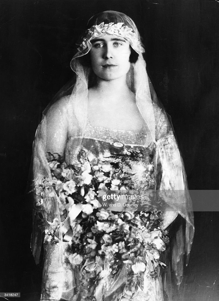 Lady Elizabeth Bowes-Lyon (1900 - 2002) dressed as a bridesmaid to Princess Mary, Countess of Harewood.