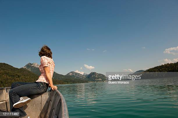 lady enjoying boat trip over lake fuschl