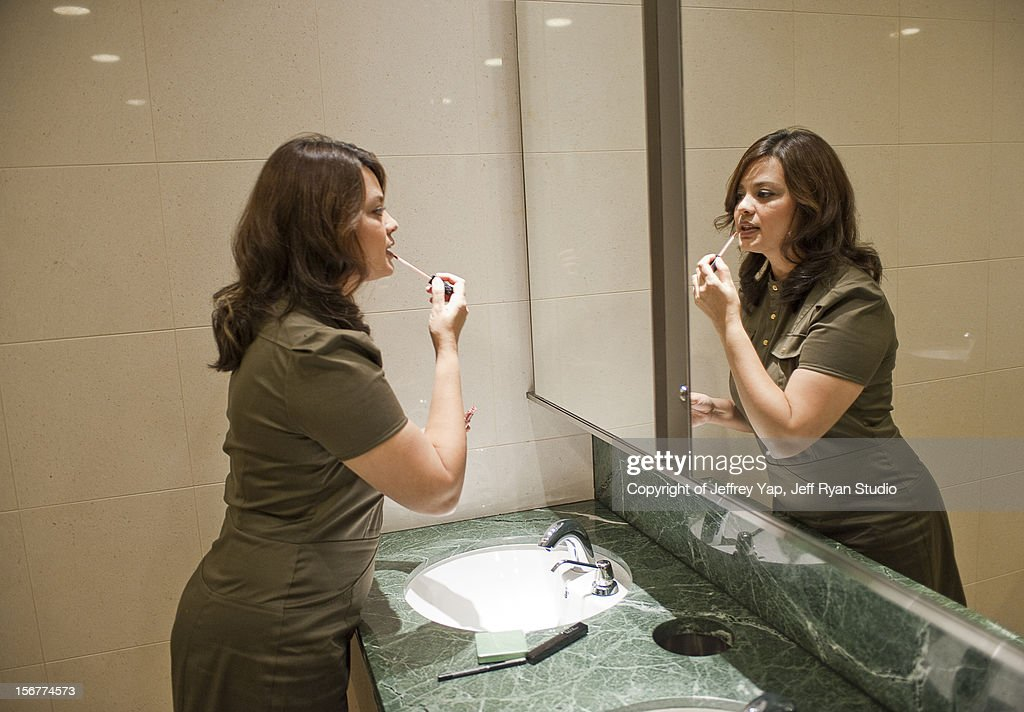 lady executive toilet makeup : Stock Photo