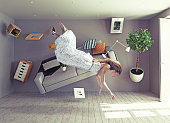 young beautiful lady flies in zero gravity room. Photo combination creative concept