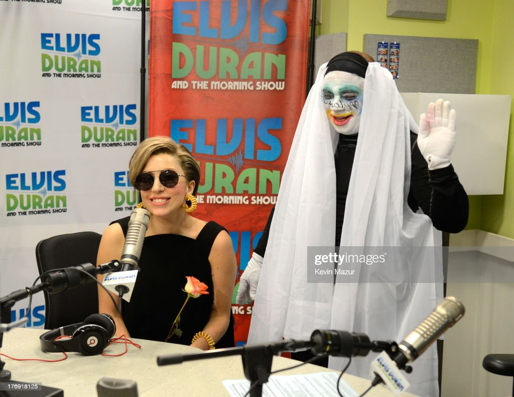 <a gi-track='captionPersonalityLinkClicked' href=/galleries/search?phrase=Lady+Gaga&family=editorial&specificpeople=4456754 ng-click='$event.stopPropagation()'>Lady Gaga</a> and Greg T. at 'Elvis Duran and the Z100 Morning Show' at Z100 Studio on August 19, 2013 in New York City.