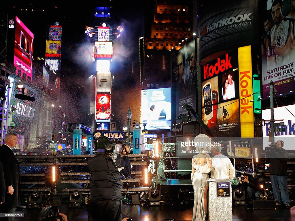 Lady Gaga and New York City Mayor Michael R. Bloomberg look on as the ball drops at the annual New Years Eve celebration on December 31, 2011 in New York City.
