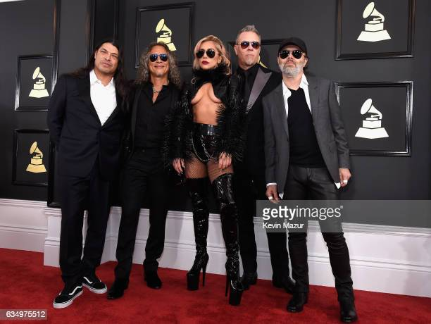 Lady Gaga and recording artists Robert Trujillo Kirk Hammett James Hetfield and Lars Ulrich of music group Metallica attend The 59th GRAMMY Awards at...