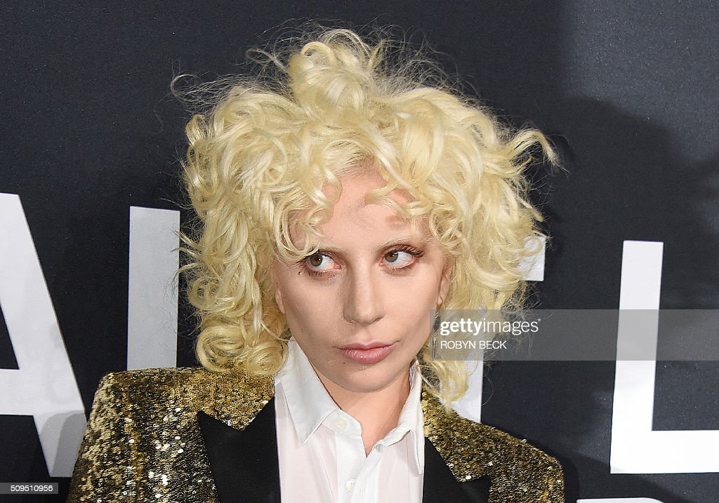 Lady Gaga attends the Yves Saint Laurent men's fall line and the first part of its women's collection fashion show at the Paladium, in Hollywood, California, February 10, 2016. / AFP / ROBYN BECK