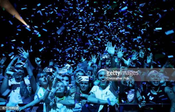 Lady Gaga fans watch her perform at the Coachella Stage during day 2 of the 2017 Coachella Valley Music Arts Festival at the Empire Polo Club on...