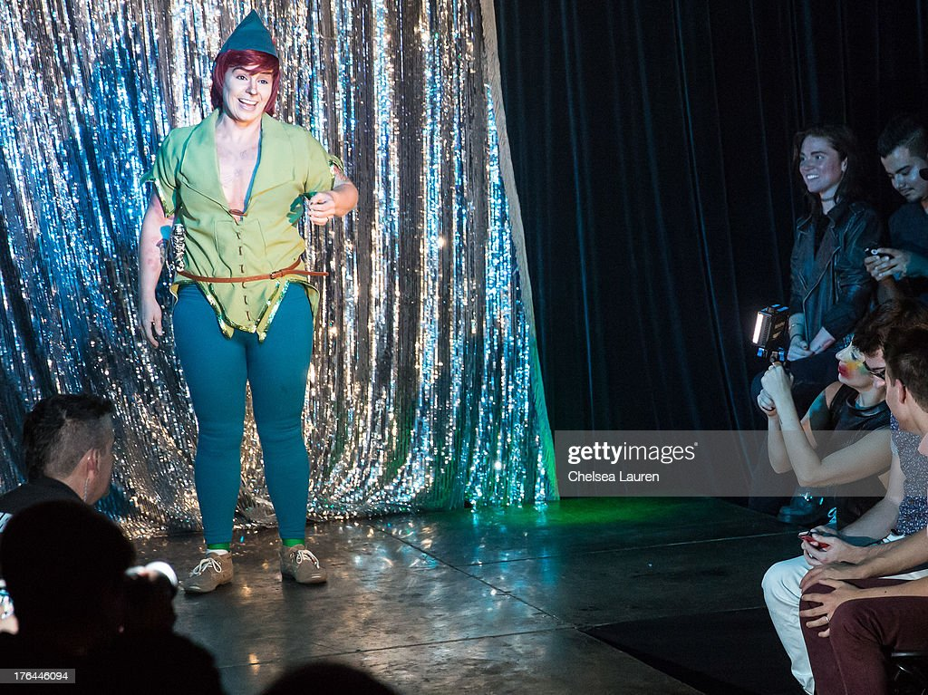 Lady Gaga (R) films drag king Landon Cider performing at a drag show with the cast of 'RuPaul's Drag Race' at Micky's on August 12, 2013 in Los Angeles, California.