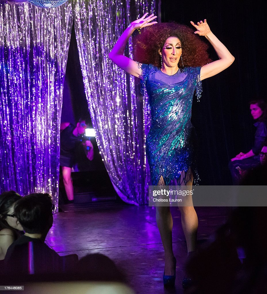 Lady Gaga (L) films drag queen Detox Icunt performing at a drag show with the cast of 'RuPaul's Drag Race' at Micky's on August 12, 2013 in Los Angeles, California.