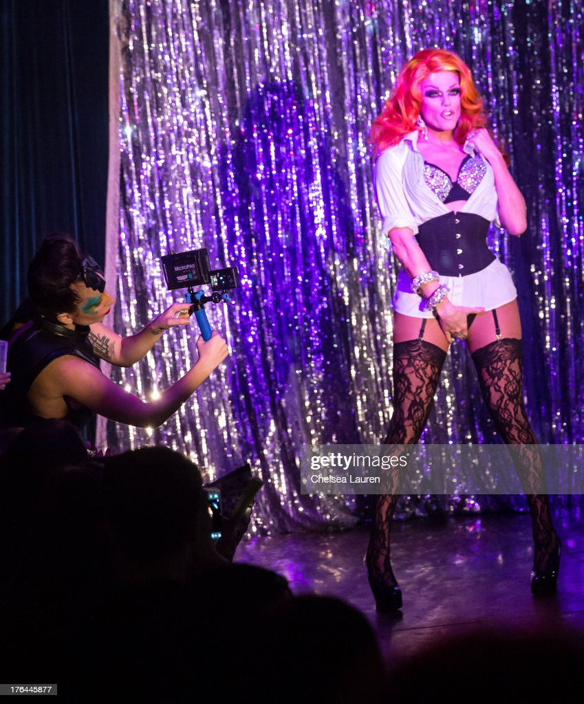 Lady Gaga (L) films drag queen Morgan McMichaels performing at a drag show with the cast of 'RuPaul's Drag Race' at Micky's on August 12, 2013 in Los Angeles, California.