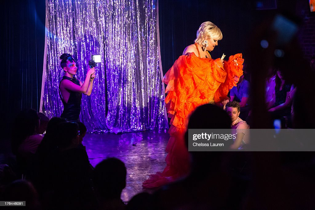 Lady Gaga (L) films drag queen Shannel performing at a drag show with the cast of 'RuPaul's Drag Race' at Micky's on August 12, 2013 in Los Angeles, California.