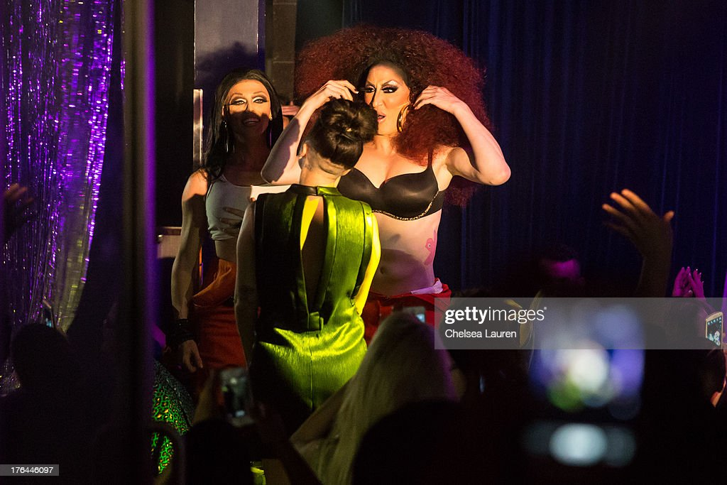 Lady Gaga (C) films drag queens Morgan McMichaels (L) and Detox Icunt (R) performing at a drag show with the cast of 'RuPaul's Drag Race' at Micky's on August 12, 2013 in Los Angeles, California.