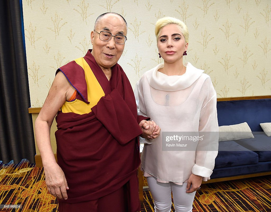 Lady Gaga (R) joins his Holiness the Dalai Lama (L) to speak to US Mayors about kindness at JW Marriott on June 26, 2016 in Indianapolis, Indiana.