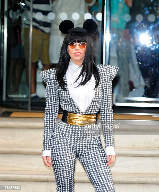 Lady Gaga leaves her London hotel wearing Mickey Mouse ears on August 31 2013 in London England