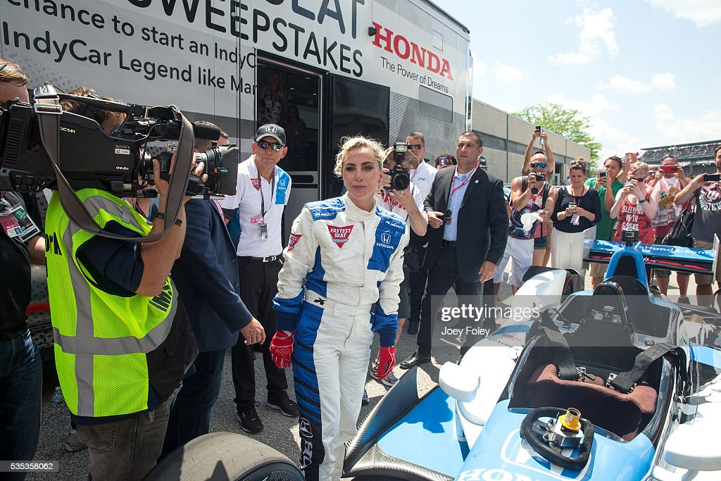 <a gi-track='captionPersonalityLinkClicked' href=/galleries/search?phrase=Lady+Gaga&family=editorial&specificpeople=4456754 ng-click='$event.stopPropagation()'>Lady Gaga</a> moments after taking a parade lap in a doubleseater Indy car driven by Mario Andretti during the 100th running of the Indianapolis 500. on May 29, 2016 in Indianapolis, Indiana.