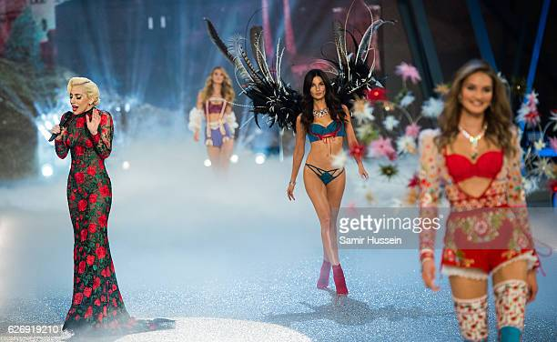 Lady Gaga performs as Lily Aldridge walks the runway during the annual Victoria's Secret fashion show at Grand Palais on November 30 2016 in Paris...