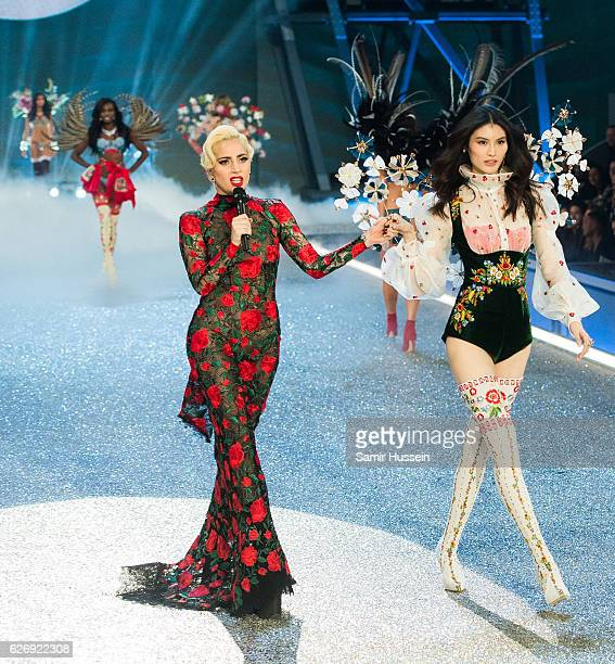 Lady Gaga performs as Sui He walks the runway during the annual Victoria's Secret fashion show at Grand Palais on November 30 2016 in Paris France