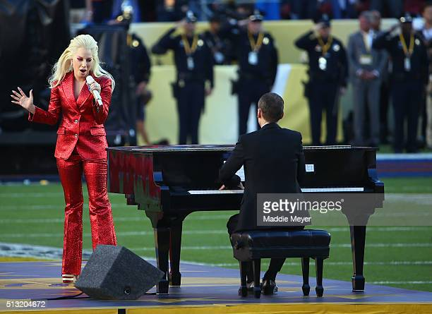 Lady Gaga performs during Super Bowl 50 between the Carolina Panthers and the Denver Broncos at Levi's Stadium on February 7 2016 in Santa Clara...