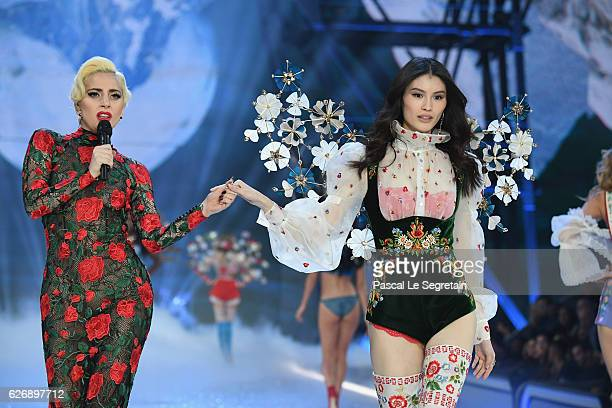 Lady Gaga performs while Sui He walks the runway at the Victoria's Secret Fashion Show on November 30 2016 in Paris France