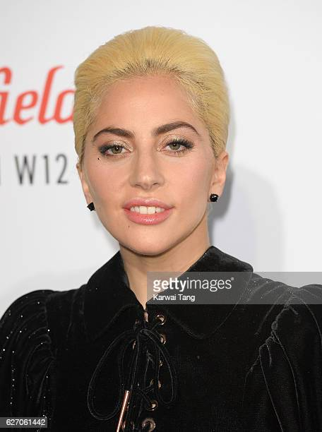 Lady Gaga poses for photographers before surprising fans with an intimate festive performance and wishing the Capital a happy holiday season at...