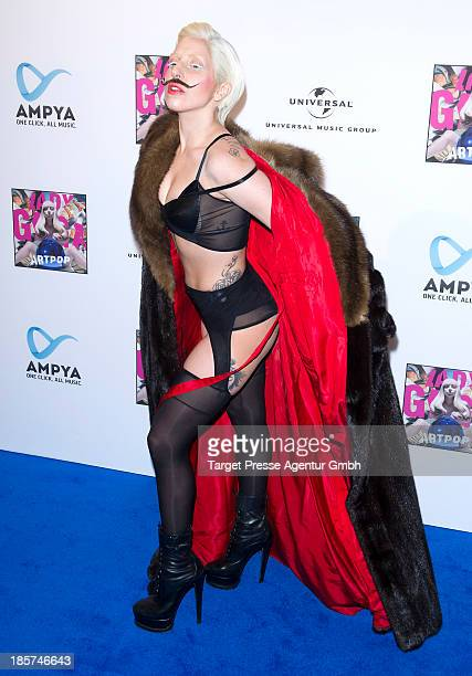 Lady Gaga poses for the press prior to the prelistening fan event of her new Album 'Artpop' at Halle Berghain on October 24 2013 in Berlin Germany