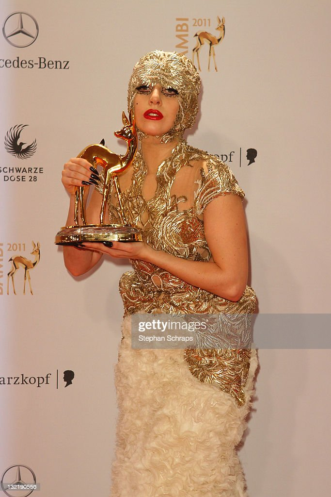 Lady Gaga poses in front of the winners board during the Bambi Award 2011 ceremony at the Rhein-Main-Hallen on November 10, 2011 in Wiesbaden, Germany.