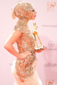 Lady Gaga poses in front of the winners board during the Bambi Award 2011 ceremony at the RheinMainHallen on November 10 2011 in Wiesbaden Germany