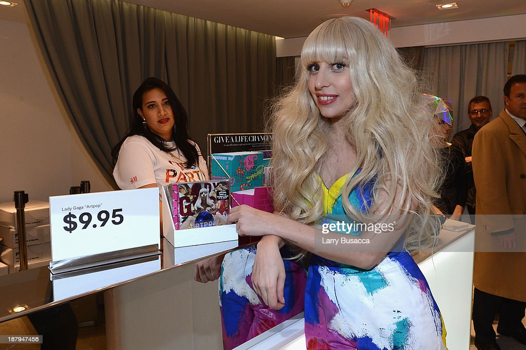<a gi-track='captionPersonalityLinkClicked' href=/galleries/search?phrase=Lady+Gaga&family=editorial&specificpeople=4456754 ng-click='$event.stopPropagation()'>Lady Gaga</a> poses inside the newly opened H&M store in Times Square on November 13, 2013 in New York City.