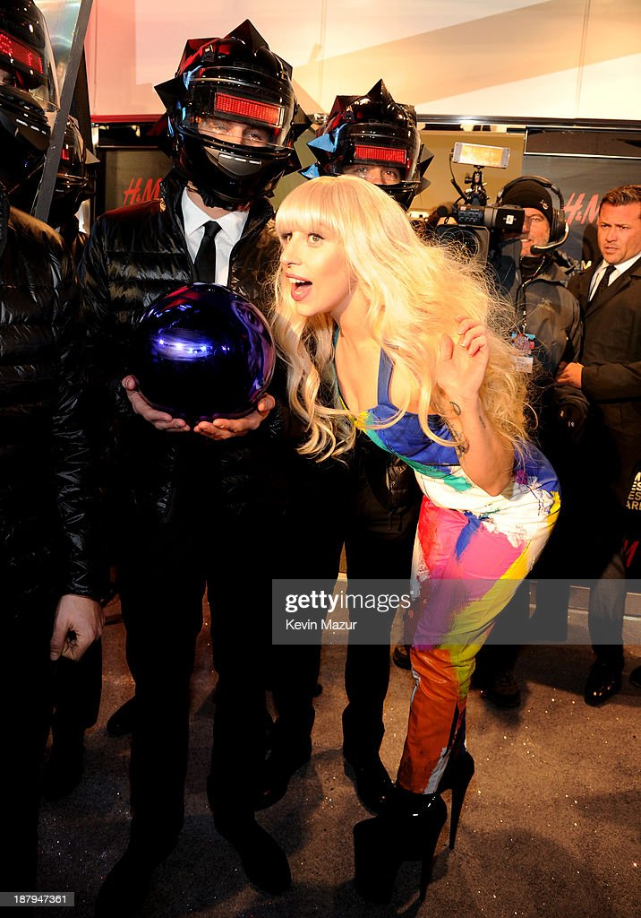 Lady Gaga poses outside the opening of an epic H&M store in Times Square on November 13, 2013 in New York City.