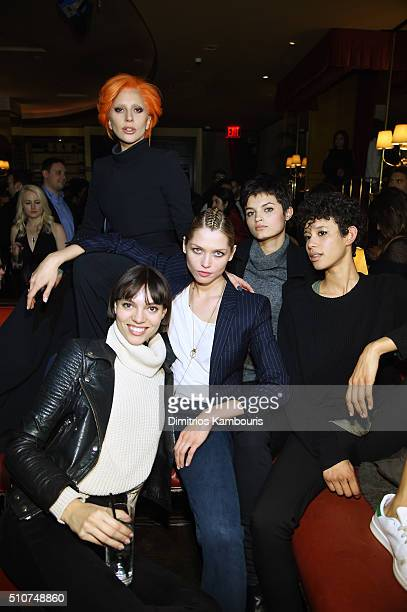 Lady Gaga poses with models at the after party for the Brandon Maxwell A/W 2016 fashion show during New York Fashion Week at The Monkey Bar on...