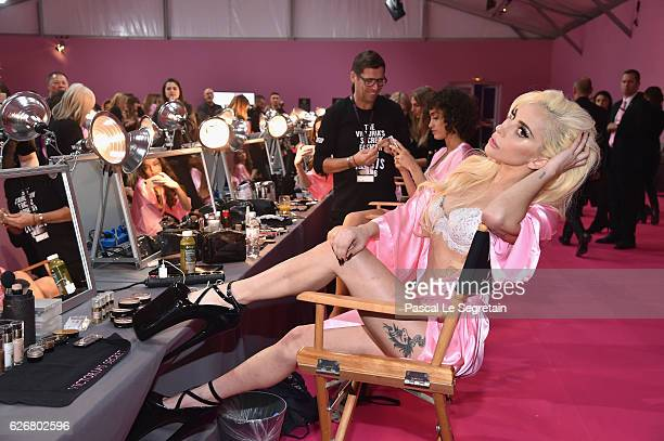 Lady Gaga prepares backstage prior to the Victoria's Secret Fashion Show on November 30 2016 in Paris France