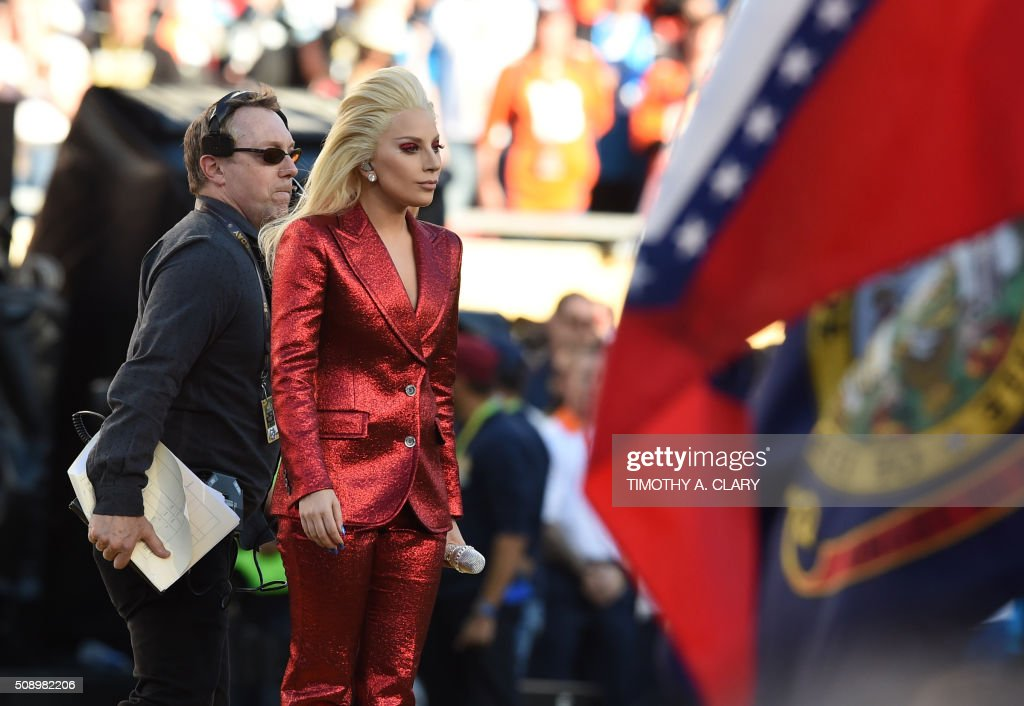 Lady Gaga prepares to sing the American National Anthem prior to the start of Super Bowl 50 between the Carolina Panthers and the Denver Broncos at Levi's Stadium in Santa Clara, California, February 7, 2016. / AFP / TIMOTHY A. CLARY