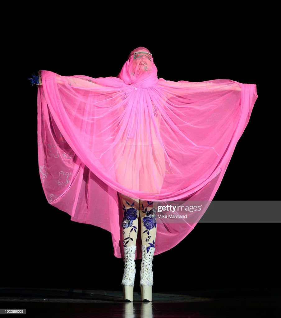 <a gi-track='captionPersonalityLinkClicked' href=/galleries/search?phrase=Lady+Gaga&family=editorial&specificpeople=4456754 ng-click='$event.stopPropagation()'>Lady Gaga</a> showcases designs on the catwalk by Philip Treacy on day 3 of London Fashion Week Spring/Summer 2013, at The Royal Courts Of Justice on September 16, 2012 in London, England.