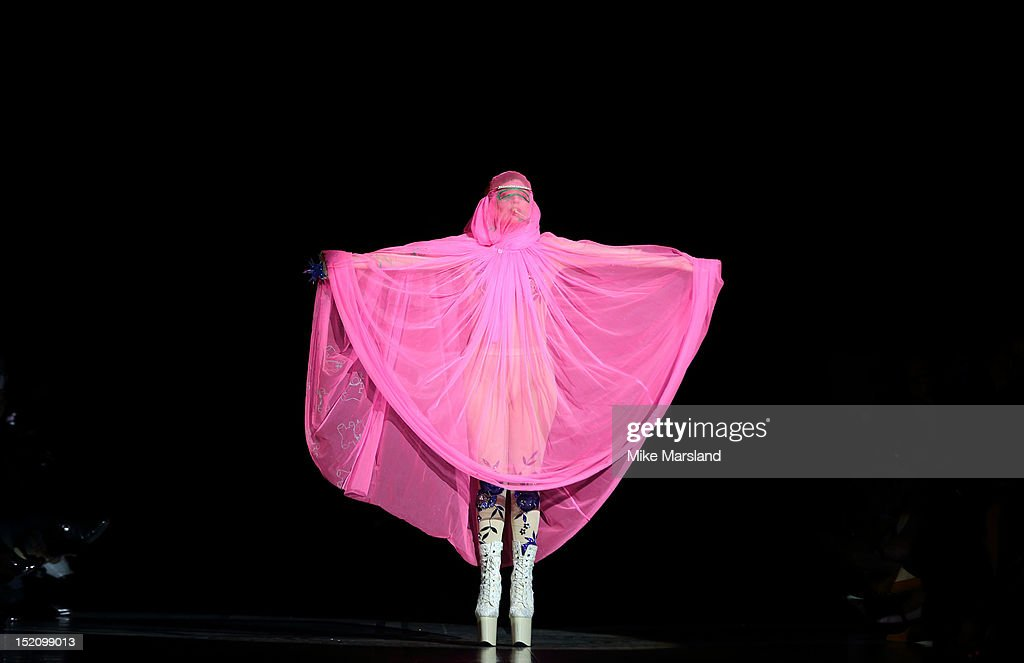 Lady Gaga showcases designs on the catwalk by Philip Treacy on day 3 of London Fashion Week Spring/Summer 2013, at The Royal Courts Of Justice on September 16, 2012 in London, England.