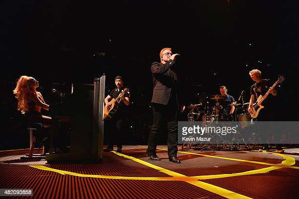 Lady Gaga The Edge Bono Larry Mullen Jr and Adam Clayton perform 'Ordinary Love' onstage during U2's 'iNNOCENCE eXPERIENCE' tour at Madison Square...