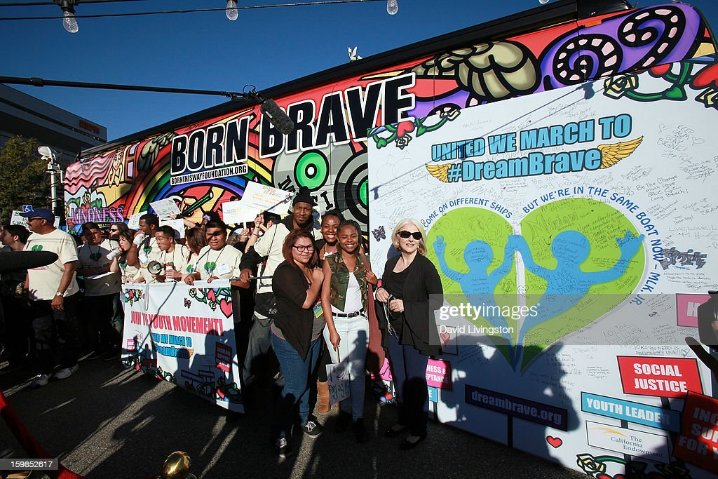 Lady Gaga's mother Cynthia Germanotta (R, in sunglasses) attends the Born This Way Foundation's 'Born Brave Bus' Pre-show Tailgate Party at STAPLES Center on January 21, 2013 in Los Angeles, California.