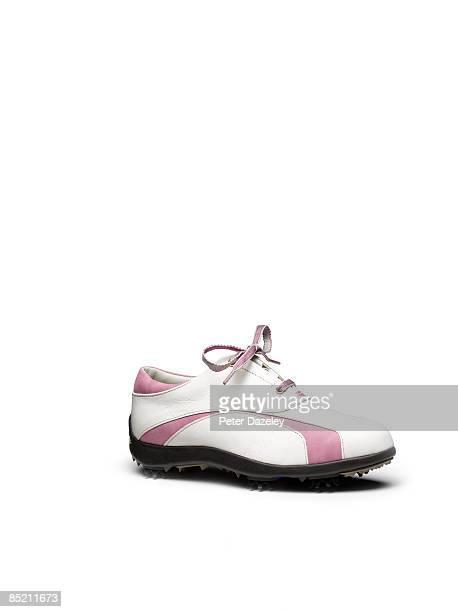 Lady golf shoe on white background.